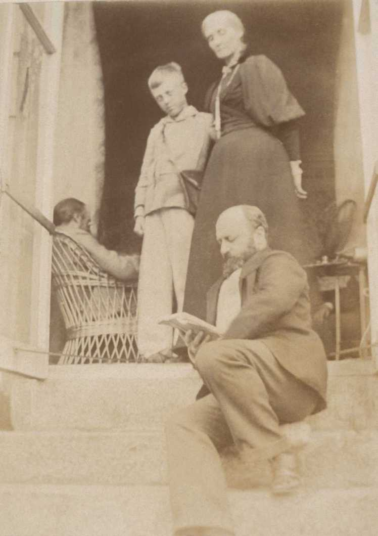 Henry James sitting on the steps at Talland House. Above him is Julia Stephen and Adrian Stephen. Photo from Smith College, MA https://www.smith.edu/libraries/libs/rarebook/exhibitions/stephen/38l.htm